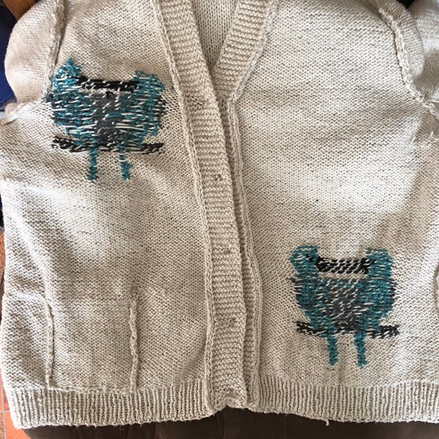 Knitting pattern showing detail of bird motif from behind